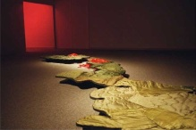skin instllation - detail, scale models of Honshu & Kushu islands skiined in military uniform linings. Atomic bombing sites marked in red wax chrysanthemums. 2001