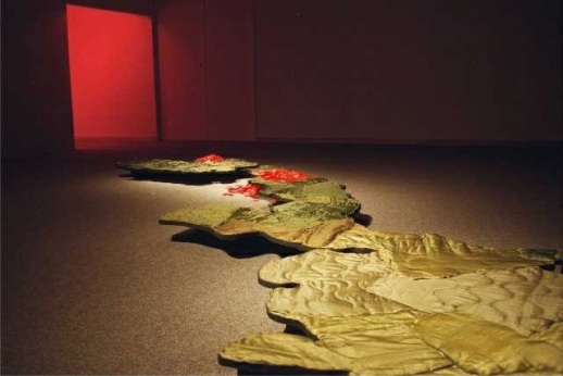 skin instllation - detail, scale models of Honshu & Kushu islands skiined in military uniform linings.  Atomic bombing sites marked in red wax chrysanthemums.  2001.jpg